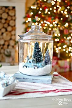 This DIY snow globe idea, made with a glass cookie jar, would be a cute addition to your vintage style Christmas decor. Gather the family around to add their own special touch to this craft idea.