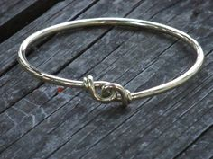 In the Norse society arm rings had several uses. They were used as a sign a boy became a man, as gifts of loyalty between a lord and his warriors, as well as a form of currency in a time before paper money and coins. These Handmade Viking style arm rings are made from 4 gauge (3/16 or 4mm) round wire. The ends are hand forged to a taper and hand knotted. They are made to fit the part of the arm you want. When ordering please tell me the measurement you want it to fit.  The fourth picture...