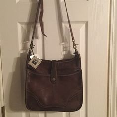 Frye hand bag New with tag , just not my style, gift and I don't have the receipt. It was not on sale . $328 before tax at Dillard's...zipper closure front full pocket with magnetic strap closer. Walnut color. #34DB329-WNT beautiful bag! Frye Bags Crossbody Bags