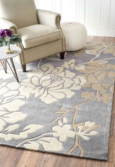 Bring simple luxuries into your home with this hand-tufted rug. This rug is woven from a Poly-acrylic blend into a transitional pattern with hand-carved details. This rug evokes a spa-like aura in any room throughout your home.