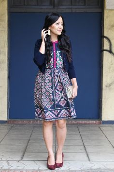 Navy Cardigan + Navy and Floral Dress + Maroon Pumps + Gold Earrings + Gold Clutch