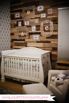 gender neutral nursery (gray and white)..rustic and modern with a wooden accent wall
