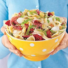 Pizza Pasta Salad by All You. Use fresh basil and oregano from your herb garden along with sun-dried tomatoes, mozzarella, and pepperoni to create a pasta salad that's full of pizza flavors. Easy Potluck Recipes, Potluck Dishes, Pasta Dishes, Cooking Recipes, Healthy Recipes, Potluck Ideas, Potluck Food, Simple Recipes, Cooking Tips