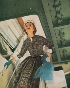 Looking dreamy in amongst the rivets, 1950s plaid dress color photo print ad hat gloves day dress model magazine