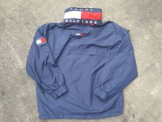 Vintage Tommy Hilfiger Colour Block Sailing Gear Jacket Very Rare COLOURWAY  DESCRIPTIONS & MEASUREMENTS  SIZE : L  PIT TO PIT : 23 INCH  LENGTH : 27 INCH  ARMLENGTH : 23 INCH  CONDITION : Vintage Condition. !! 1 Button is missing from the hood as u can see in picture 5 !!   PAYMENT INSTRUCTIONS : Paypal, VISA & Mastercard are the type are accepted payments.   SHIPPING & HANDLING INFORMATION : I ship worldwide with REGISTERED Air MAIL and I provide a tracking Number.  International orders…