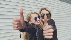 Buy this footage and other same: shutterstock.com/video/clip-28563985 #stockvideo #footage #sales #usa #sunglasses #america #losangeles #newyork twogirls #bestfriends #glasses #blondie #fun #lovely #friends #like #goodmood Two smiling stylish girls in leather jackets and sunglasses show a gesture of thumbs up. Background of white horizontal rolling shutters.