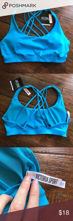 BNWT Victoria secret sports bra with pads - medium SO cute great strappy back wished it had fit me :) it does come with bra pads - priced to recoup my money Victoria's Secret Tops