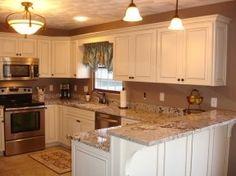 LOVE this kitchen! Canvas with cocoa glaze cabinets. Bianco Antico countertop