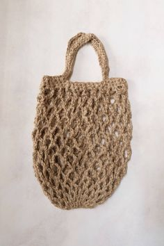 Whether you're strolling through the farmers market or relaxing on the beach, this crocheted market net bag is perfect for carrying fresh fruit or sunblock along with your favorite book. Made of natural twine with a tightly woven bottom that helps keep your items in place. . Twine . #zerowaste