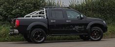 "Lifted Nissan, 3"" Exhaust, Aluminium sport back cover, Black wheels, Auxiliary gauges."