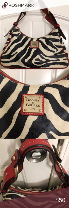 Dooney & Bourke zebra bag Gorgeous D&B zebra bag, for all you animal print lovers, this is the bag for you!  Super great condition, no signs of wear.  Red leather handles.  Just cute all the way around! Dooney & Bourke Bags Shoulder Bags