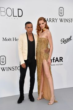 French fashion deisgner Olivier Rousteing (L) British model Alexina Graham pose as they arrive for the amfAR's 24th Cinema Against AIDS Gala on May 25, 2017 at the Hotel du Cap-Eden-Roc in Cap d'Antibes, France. / AFP PHOTO / ALBERTO PIZZOLI