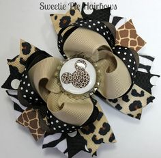 Minnie Mouse Safari Hairbow Zebra Deluxe Boutique Hair Bow Set So Cute for Disney Cheetah Giraffe Zebra. $9.99 USD, via Etsy.