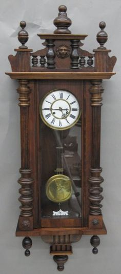 Antique clock regulator clock with horse carving and cherubs on