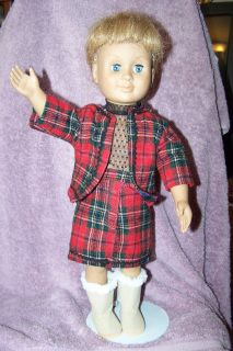 """This traditional style Jacket and Skirt are constructed of Red and Black Plaid pattern wool, and lined in dark blue silky suit lining, stitched in matching red and black thread. There is black baby RikRak trim along the skirt hemline, and around the body and hem of the jacket. The colors in the plaid pattern consist of Red, Black, Blue, White, and a hint of Green. The skirt lining, is hemmed just above the skirt hem. The skirt secures at the front, with a """"fly"""" style flap lined with cotton…"""