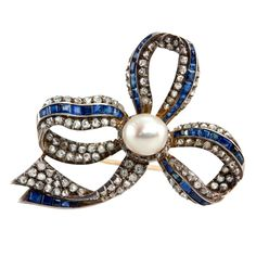 Sapphire and Diamond and Pearl Bow Brooch | From a unique collection of vintage brooches at https://www.1stdibs.com/jewelry/brooches/brooches/