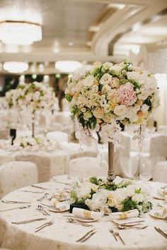 Table flower arrangements. Lincoln and Calista's Sumptuous Singapore Wedding at Mandarin Oriental