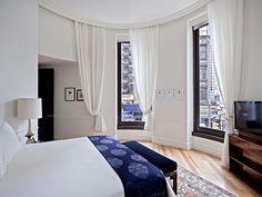 """""""OLD WORLD MEETS MODERN-DAY: THE NOMAD HOTEL""""    crown moulding hiding curtain rail"""