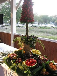 Strawberry topiary and fruit display slightly smaller centrepiece than the pineapples but same idea