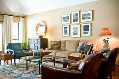 Living room with tan sofa and walls, peacock blue Oriental rug, chair and throw pillows, turquoise glass bottle, brown leather chairs, and a rustic wood dough trough - by Allison Jaffe Interior Design - photo by Brio Photography