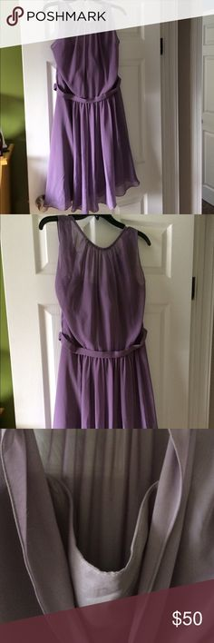 Light Purple (Wisteria) Bridesmaid Dress This is a new dress with tags still attached. I ordered it for a wedding and it did not arrive in time so I never got to wear it. It is Gather & Gown, Porter style, and the color is wisteria.  The top is sheer, with a structured bodice underneath. Here is some info from the manufacturer--Light chiffon. Gently ruched jewel neckline. Banded waist. 100% polyester. Boning, covered back zip. Lined. Dry clean. Gather & Gown Dresses