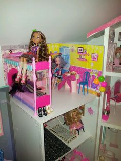 Dollhouse Update: Birthday haul, we redecorated to create space for her new Ever After High dolls. Using foam board and cutout from new Barbie dinner set for Madeline Hatters space and laminated it; we took the old kitchen table from the main house for her tea party. Scrapbook paper and cutouts from the doll boxes for Raven Queen and Cedar Wood's area. Their furniture is from an ebay lot. #EverAfterHigh #DIY #DollRoom #RavenQueen #CedarWood #MadelineHatter