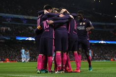 Lionel Messi of Barcelona celebrates with his teammates after scoring the first goal to make the score 01 during the UEFA Champions League match...