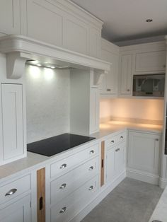 classiccabinetry.co.uk  Farrow & Ball Purbeck Stone and Amonite with Silestone Lagoon work tops