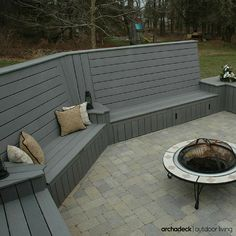 Gray composite deck with high-back built-in benches for seating and privacy. Double Wow!