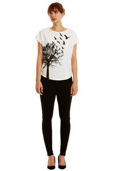 White t-shirt with tree print in 100% organic certified cotton jersey. Length 62cm.