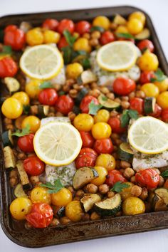 Greek Lemon Baked Fish with Tomatoes, Zucchini and Chickpeas – thecomfortofcooking.com