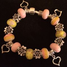 """European Bracelet made with SS bracelet Bracelet beads on is SS. Bead cores SS. Beads are Lampwork, Ceramic, and silver plated if complete silver bead. Fits wrist 7"""" to 7.5 inch. Handmade Jewelry Bracelets"""