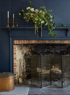10 Historic Homes for Modern Creative Families (Design*Sponge) Navy paint and exposed brick -- beautiful. 10 Historic Homes for Modern Creative Families Small Fireplace, Fireplace Design, Fireplace Ideas, Fireplace Guard, Brick Fireplace Paint, Painted Fireplace Mantels, Painted Mantle, Basement Fireplace, Vintage Fireplace