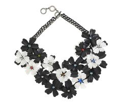 Graphic Bloom Necklace. Beautiful and sophisticated monochrome flowers adorn this corsage style, hand beaded necklace with multiple rows of blooms from Forest of Chintz, perfect for making a bold statement.  Features 3D acrylic beads and crystals on a metal chain. Wear this dramatic piece with an LBD or jumpsuit and heels; or dress up a simple tee. Perfect for cocktails. #fashion #style #necklace #jewelry