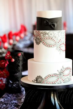 Belgian tux cake, with gorgeous lace patterns and red accents ♥