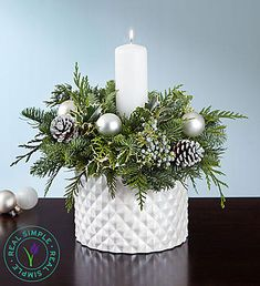 Decorate table decor with Christmas floral centerpieces! Holiday floral centerpieces come in all shapes & sizes for the best 2019 Christmas centerpieces! Christmas Candle Decorations, Christmas Flower Arrangements, Winter Centerpieces, White Centerpiece, Christmas Flowers, Floral Arrangements, Christmas Holidays, Christmas Wreaths, Christmas Crafts