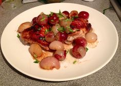 Grilled miso chicken thighs with grapes, shallots and tarragon.