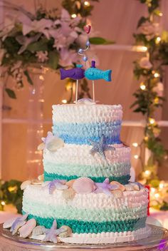 """""""There are two less fish in the sea"""" wedding cake. Photo by Nicole Gillihan Photography."""