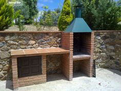 Barbacoa de obra de la casa rural Casa de Piedra