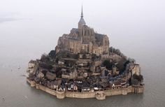 - In this March 2015 file photo, a high tide submerges a narrow causeway leading to the Mont Saint-Michel, on France's northern coast. Authorities are evacuating tourists and others from the Mont-Saint-Michel… Machu Picchu, Site Face, The Mont, Mont Saint Michel, World Heritage Sites, Aerial View, Belle Photo, Best Hotels, Paris Skyline