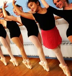 I think shes a little young for pointe! And the fact that she's the only one wearing any color besides black