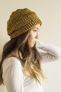 Texture and drape make this little trendy little slouch hat a fun and comfortable knit - find the pattern on LoveKnitting!