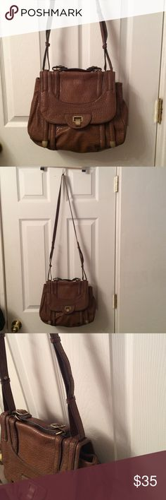 """Jessica Simpson crossbody. Jessica Simpson crossbody bag.  Great condition! On pen mark on the inside lining, about 1 inch long. Other than that, no flaws! Strap is not even worn.   The bag itself is 14"""" x 10"""".  The length including the handle on the setting it's on now is 35"""".   Has one zipper pocket inside, along with 2 open pockets. Jessica Simpson Bags Crossbody Bags"""
