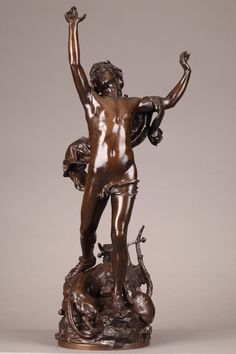 Patinated bronze sculpture of Orpheus, the mythological poet from Thrace. He is standing on a rock with his lyre and Cerberus at his feet. Signed on the base: Raoul Vernet. Produced by F. Barbedienne, Paris foundry. Stamped: Réduction mécanique A. Collas. $3,750.00