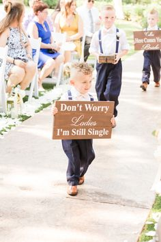 "| cute ring bearer sign idea | wedding signs for the ring bearer during the ceremony | ""don't worry ladies I'm still single"" 