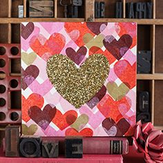 A perfect DIY Valentine's Day gift! Make heart wall art using tissue paper, glitter, and decoupage. Learn how with our easy tutorial.
