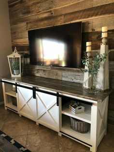 This is a sliding barn door/farmhouse media console we just finished building. T... - #barn #building #Console #doorfarmhouse #finished #media #sliding