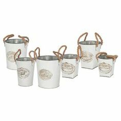 """Set of 6 planters with rope handles and typographic detailing.  Product: 2 Small, 1 medium and 3 large plantersConstruction Material: Metal and ropeColor: White and naturalDimensions: 9.05"""" H x 9.65"""" Diameter (largest)"""