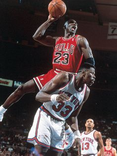 Michael Jordan powers over Patrick Ewing for a dunk during a 1991 Bulls-Knicks game.