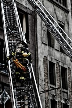 Firefighter on his ladder.<br><br> <br /><br>Firefighters response in force to a blaze near Fifth Avenue in New York Firefighter Paramedic, Volunteer Firefighter, Firefighter Tattoos, Fire Dept, Fire Department, Hot Shots, Firefighter Pictures, Into The Fire, Fire Apparatus